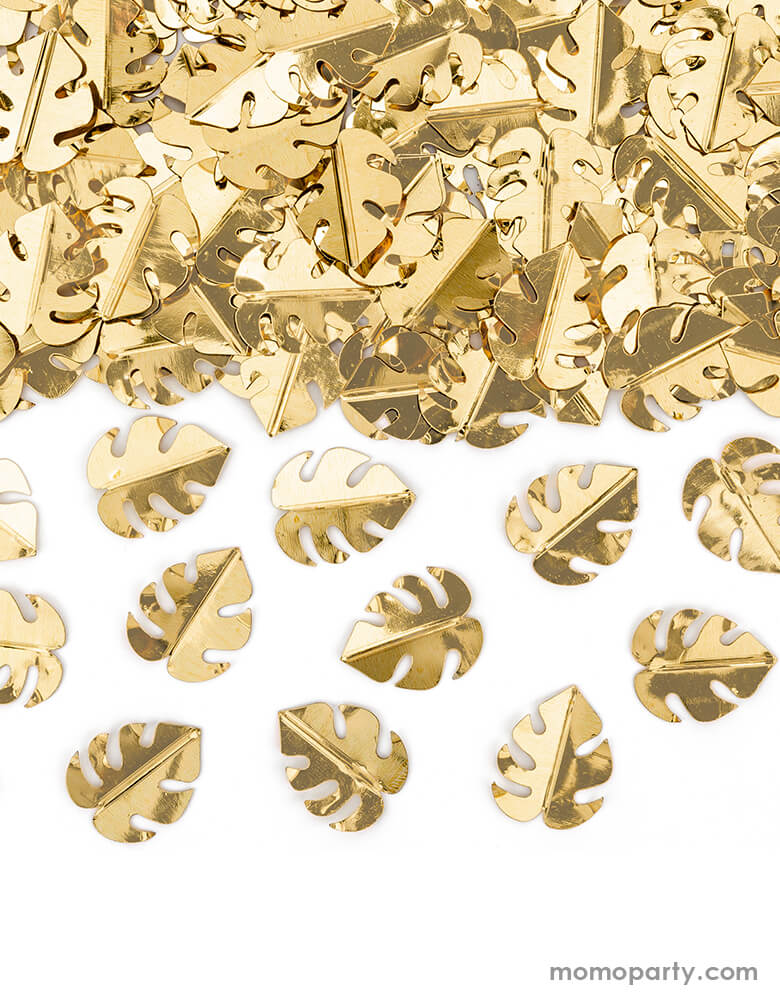 Close up look of Party Deco Palm Leaf Gold Confetti. This confetti features Palm leaf shape cutouts with gold foil. Add some fun to your jungle, dinosaur or tropical themed party by spreading this set of palm leaf confetti in metallic gold to your table! party supply accessories Sold by Momo party store provided modern party supplies, boutique party supplies, chic holiday party supplies and high end party supplies