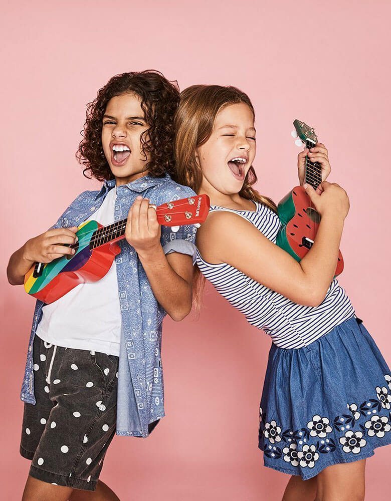 boy and girl playing with Sunnylife Watermelon Ukulele
