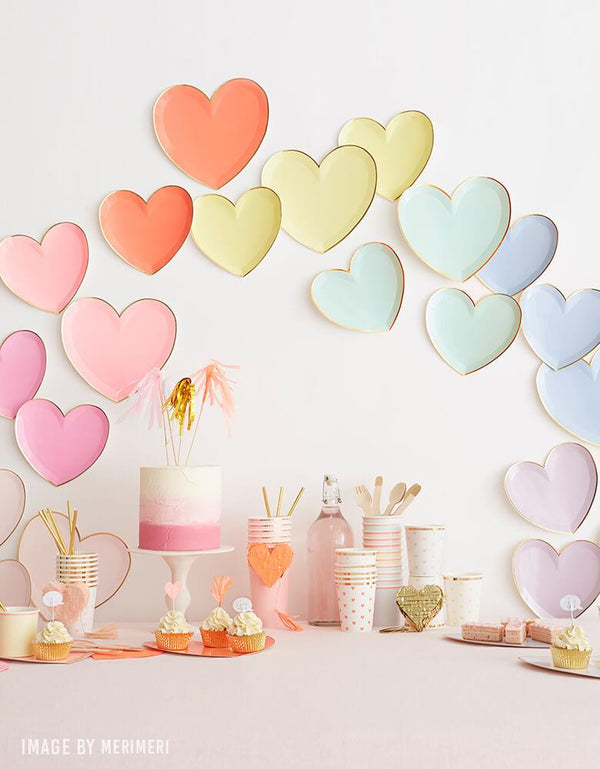 Valentines day party ideas of backdrop wall decoration with Meri Meri Party-Palette-Heart-Large-Plates, pink naked cake, cups, desserts