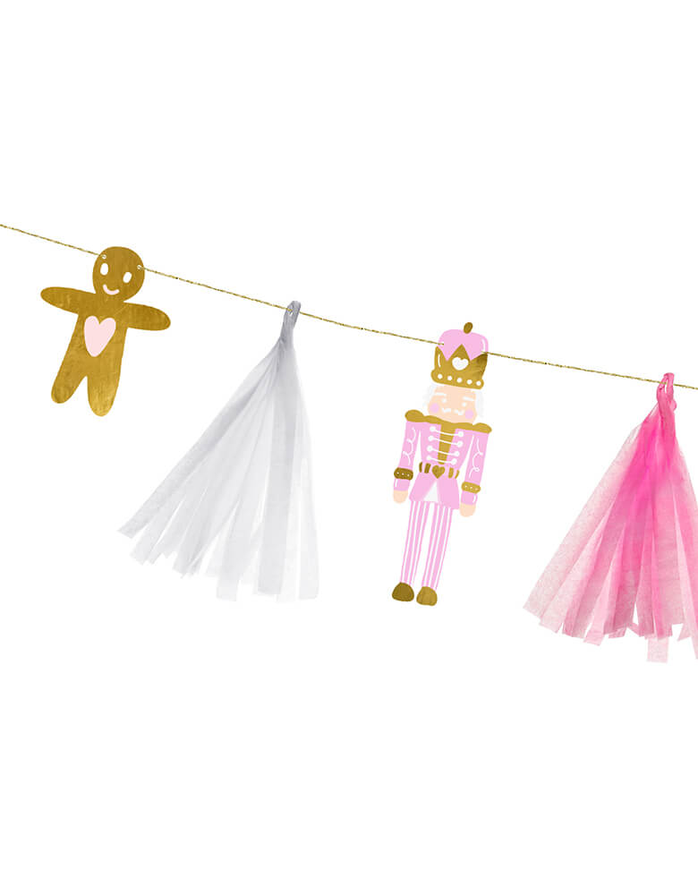 A close up shot of Party Deco 7.5ft Pink Christmas Paper Garland featuring gingerbread man, nutcracker, and peppermint designs with gold, white and pink tassels  Edit alt text
