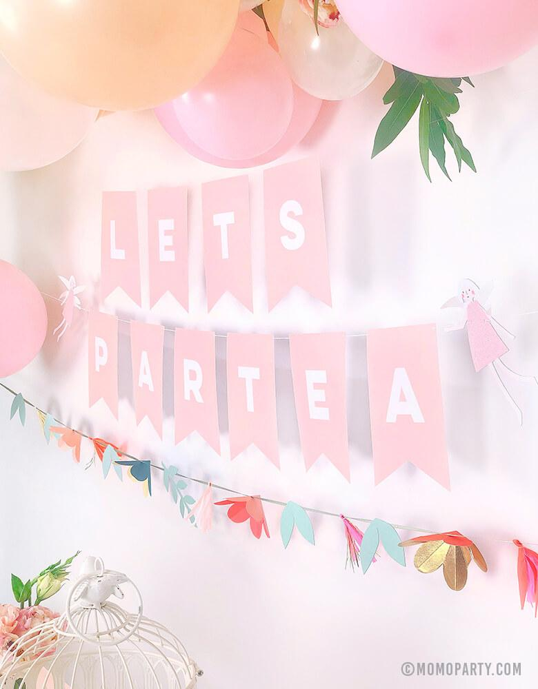 "Pastel Tea Party decorated with pastel balloon garland with flowers, My Minds Eye's Pink Letter banner with customized with ""Lets Partea"" and Meri Meri Fairy Garland"