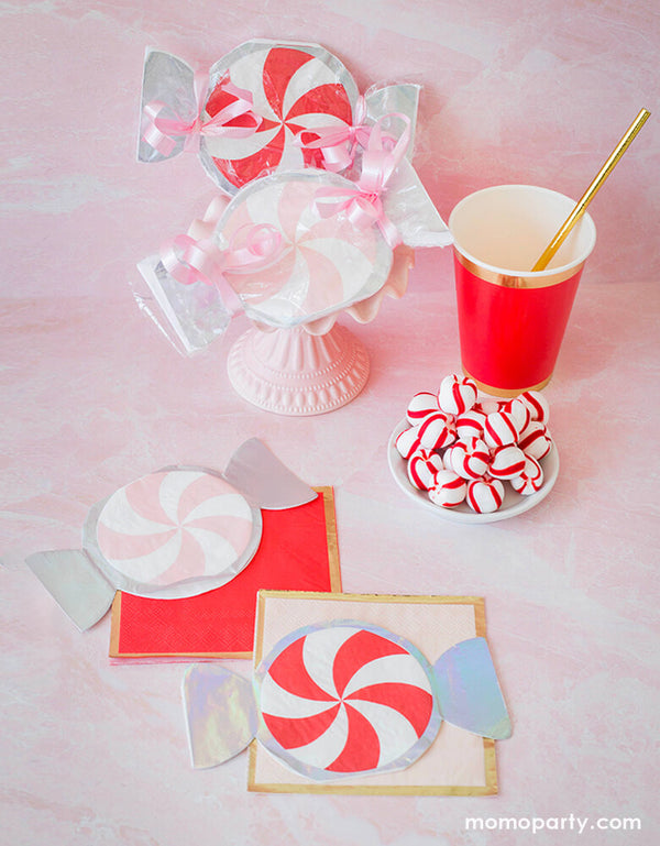 "A sweet holiday dessert party inspiration with Pink and Red Peppermint Small Napkins, Posh Cocktail Napkins - Red ""Ruby Kiss"" color and Pink ""On Wednesdays"" color, peppermint, cups with gold paper straw on a pastel pink background"