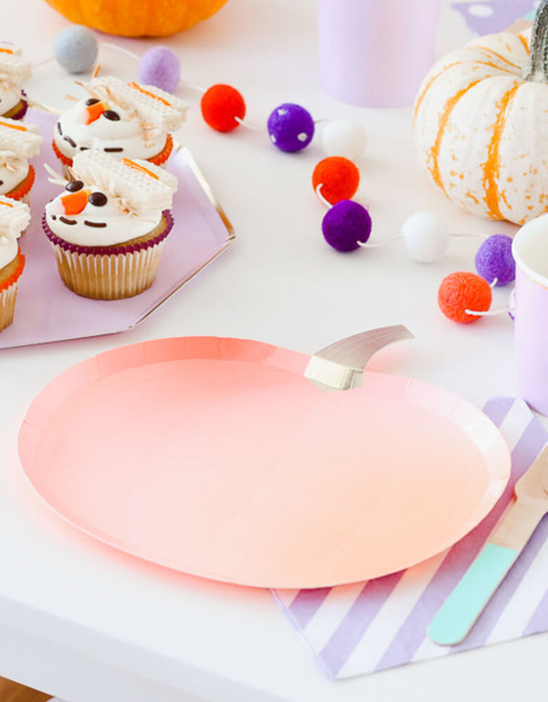 Pumpkin paper plate with a lilac plate featuring scarecrow cupcakes for a Fall inspired party for kids