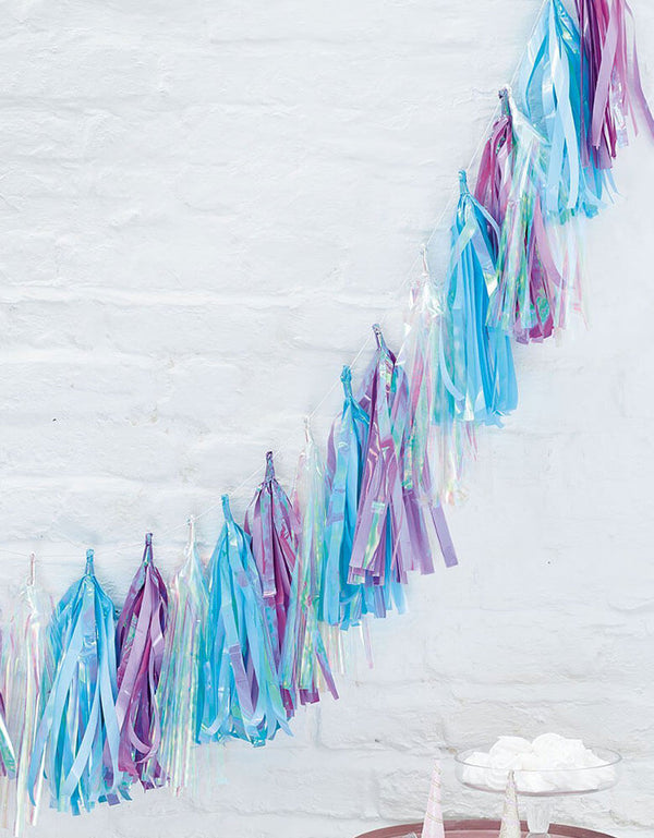 Talking Tables_Purple, Blue, Silver Iridescent Tassel Garland on a white wall