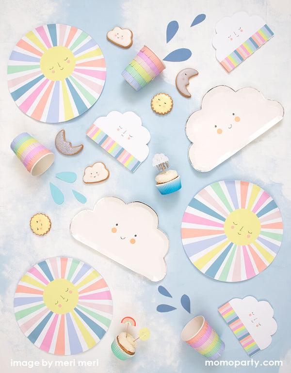 A sunshine themed birthday table filled up with Meri Meri Rainbow Sun Dinner Plates, Rainbow Sun Cloud Napkins, Happy Cloud Plates, Rainbow Sun Cups, Happy Weather Cupcake Kit with cute cloud, moon, sun shaped cookies. These sunshine themed collection featuring a sweetly smiling face and colorful fringed details. They are perfect for any celebration, including baby showers or you are my sunshine themed birthdays or any kids birthday.