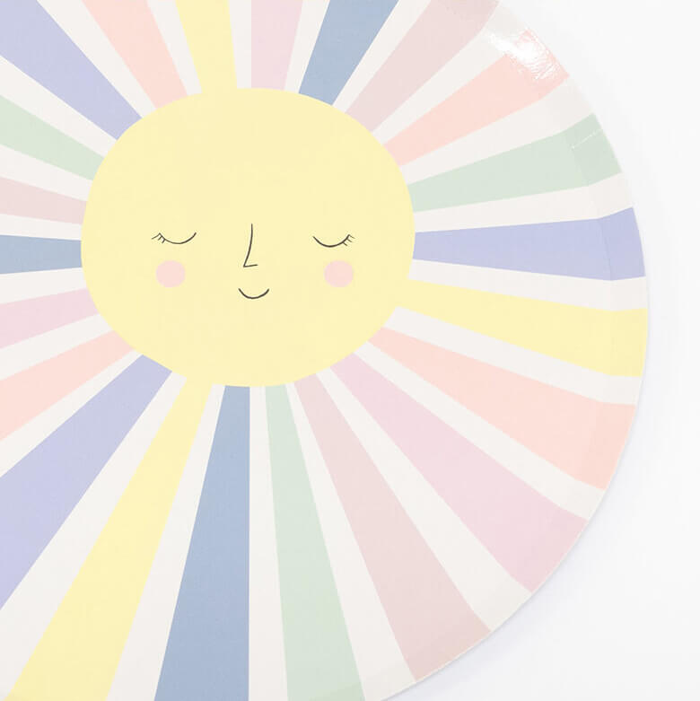 detail look of meri Meri Rainbow Sun Dinner Plates. They feature a smiling sun with lots of colorful rays.