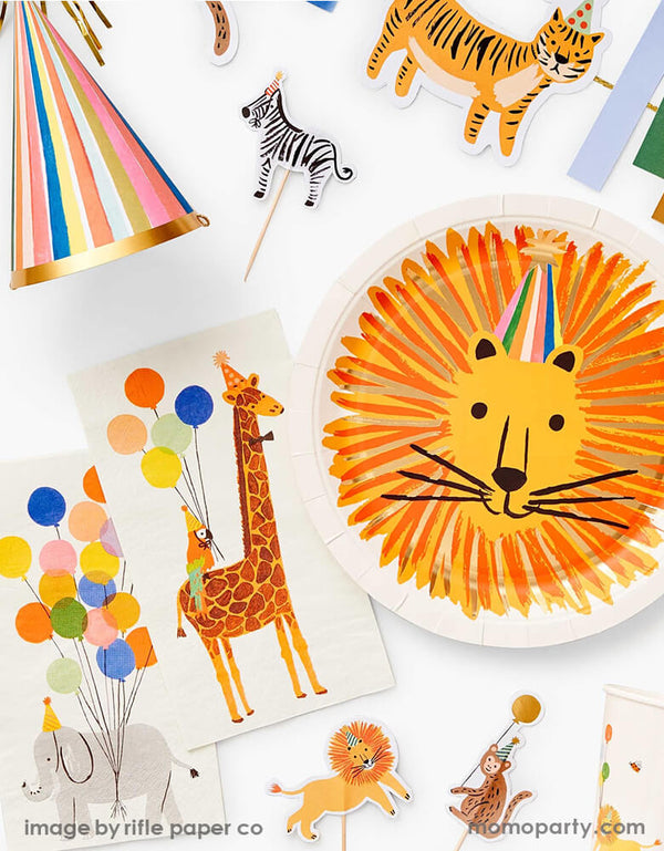 Party Animal birthday table top filled with Rifle Paper Co Party Animals Large Plates with Lion head design, Party Animals Guest Napkins, Party Animals Cups, Party Animals Cupcake Kit, Feliz Party hats from Rifle-Paper-Co New Party Animals collection. These modern designed partyware will bring an extra dose of fun to your party table, 1st birthday party, party animal themed party, zoo themed party, get wild party, safari animal themed party, kids birthday, or any animal lovers party