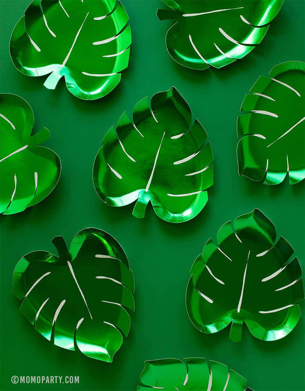 Meri Meri Party ware of Green Palm Leaf shaped Foil Paper Plates with green backgound