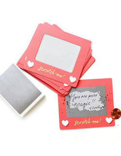 Inklings Paperie® - Scratch A Sketch Valentines card. Hide your message in a scratch-off with this set of 6 scratch-off notes by Inklings Paperie! Using any pen or pencil, write your message in the designated area, cover it with a silver scratch-off sticker provided, and scratch to reveal your hidden message! These tiny notes are the perfect size to slip into a lunch box or pocket of someone special.