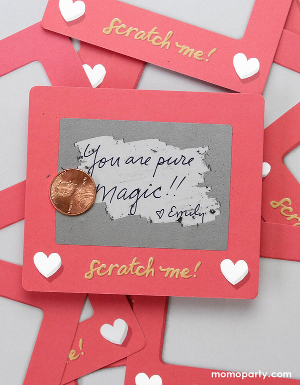 "Inklings Paperie® Scratch A Sketch Valentines card scratched by a quarter, revealing the message of ""you are pure magic! love emily"" . Hide your message in a scratch-off with this set of 6 scratch-off notes by Inklings Paperie! Using any pen or pencil, write your message in the designated area, cover it with a silver scratch-off sticker provided, and scratch to reveal your hidden message! These tiny notes are the perfect size to slip into a lunch box or pocket of someone special."