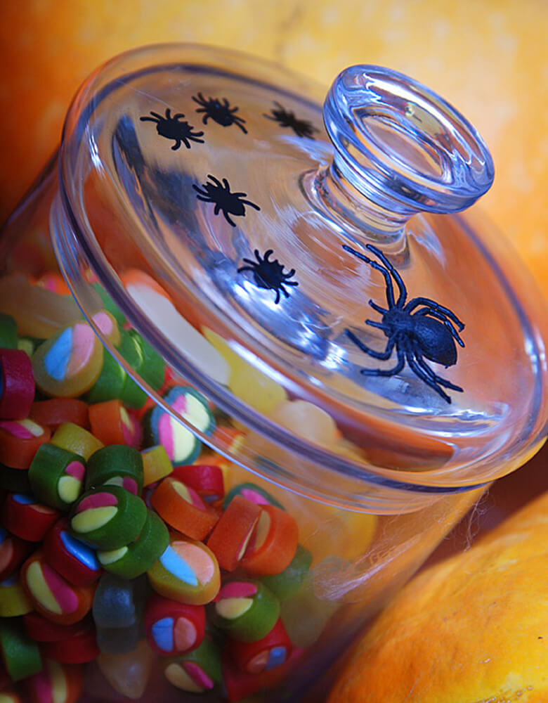 Party Deco Halloween Spider confetti in a candy jar. also you can add some fun to your Halloween party by spreading this set of spider confetti to your table