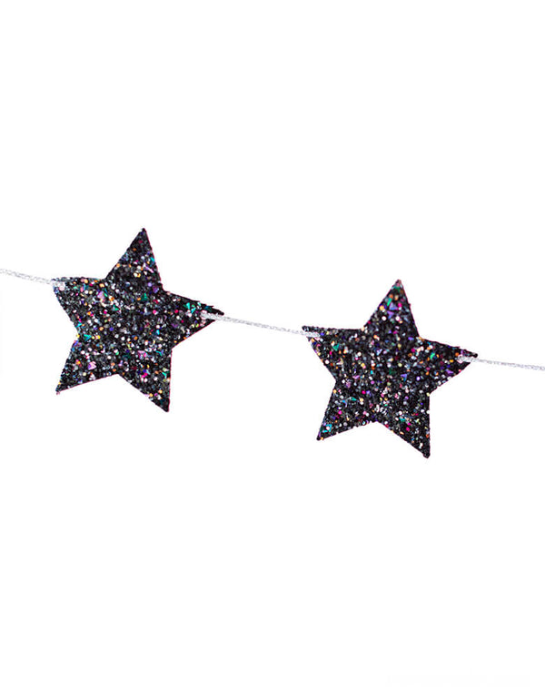 Close up Details of Studio Pep Midnight Shining Stars Banner in Chunky glitter and tinsel fabric. This glittered star banner in beautiful midnight color is simply stunning! It's hand-pressed and is cut from high quality, neon-edge vinyl. It's perfect for space or Star Wars themed celebrations or decorating your mantle or the little one's shelves in the playroom!