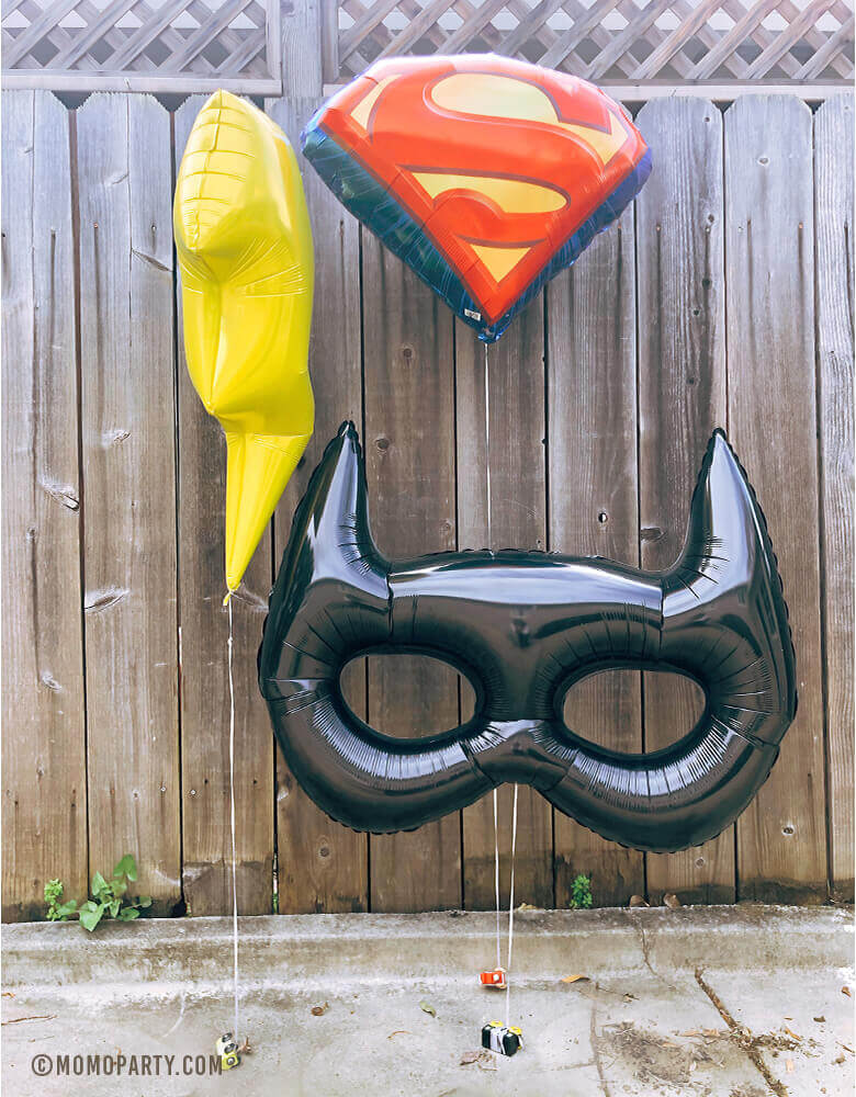 Outdoor Super Hero party with Giant Bat Mask Foil Balloon, Superman Emblem Foil Balloon and Bat Mask Foil Balloon