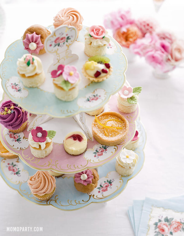 Truly Chintz 3-tiered paper board Cake stand full with cupcakes, tarts, cute flower look small bite sweets  on top of each tier, fresh flowers and vintage flower napkins on the table. Ready for the little tea party , Afternoon Tea Party, Vintage Style Tea Party