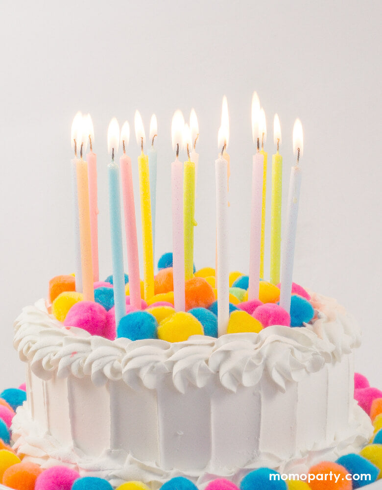 Party Partners - Tall Pastel Rainbow Glittered Candles on the white buttercream cake