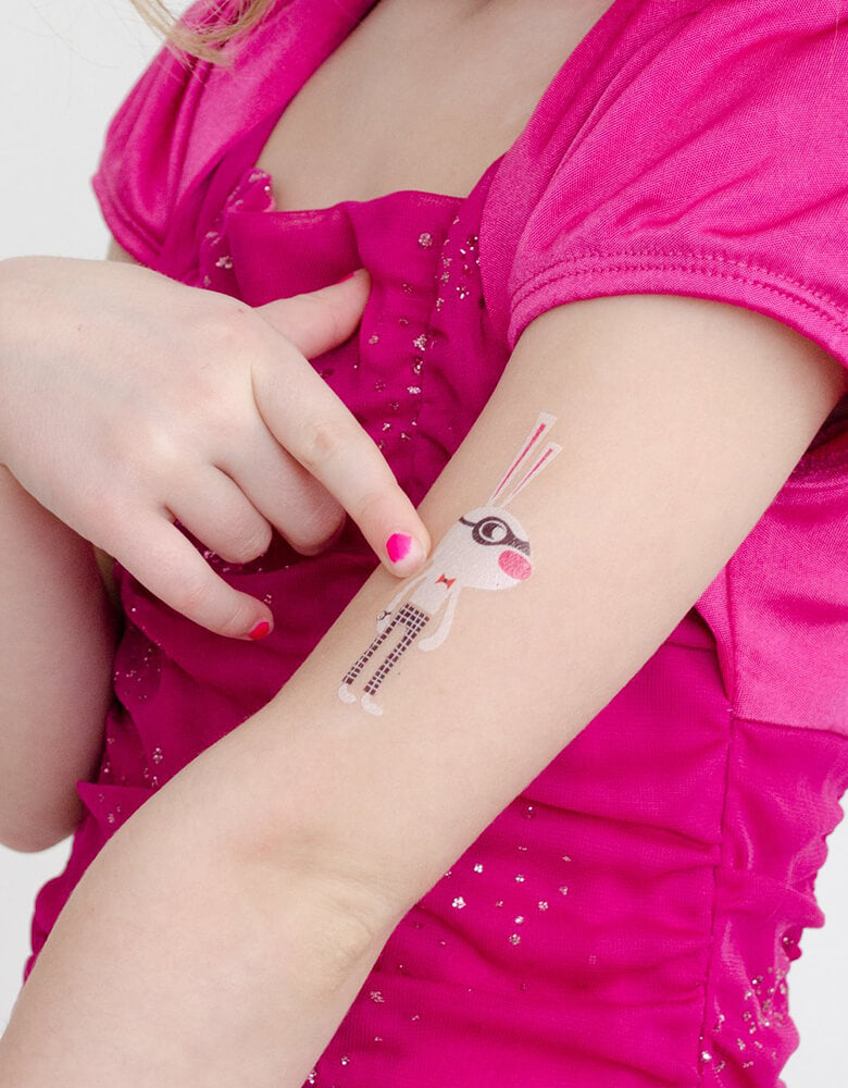 Girl wearing Funny Bunny Tattly safe and non-toxic Temporary Tattoos of Zoo Crew Set By Helen Dardik on her arm at birthday party