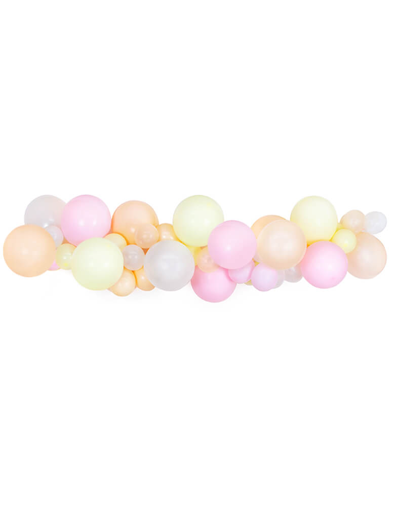 A beautiful pastel balloon garland with light pink, pastel yellow and peach colors