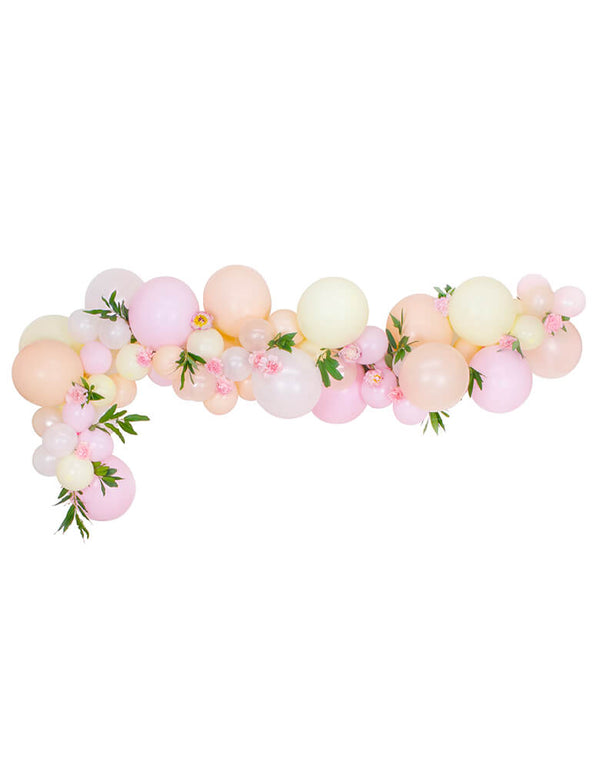 A beautiful pink blush pastel balloon garland with flower decoration
