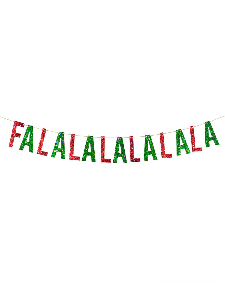 "Studiopep, Tinsel Falala Artisan Banner in Red and Green letters of ""Fa La La La La La La"", This hand-pressed artisan banners is cut from high quality, glitter fabric and includes thick glitter cord"