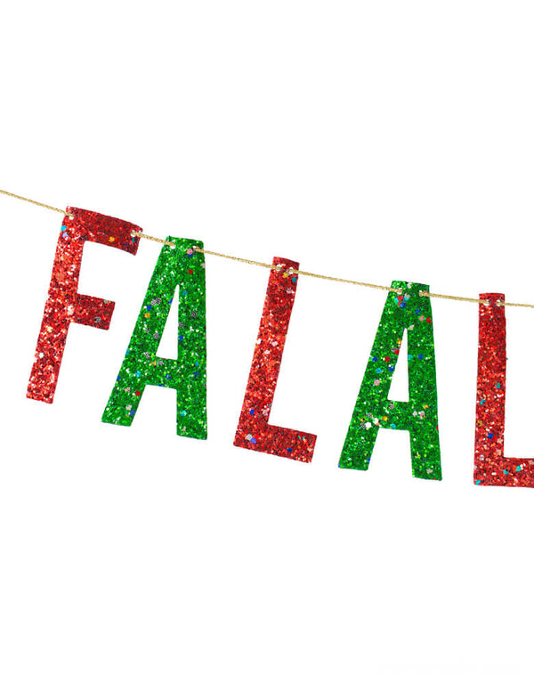 close up details of Fa La La of Studio Pep Tinsel Falala Artisan Banner. This hand-pressed artisan banners is cut from high quality, glitter fabric and includes thick glitter cord