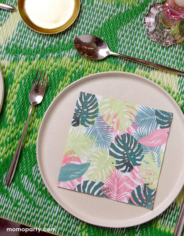 Tropical themed party table look with  Fiesta Pink Palm Napkins on top of pink ceramic round plates, with green bamboo table mat. Perfect for a tropical party, summer birthday, picnic, BBQ or garden party!