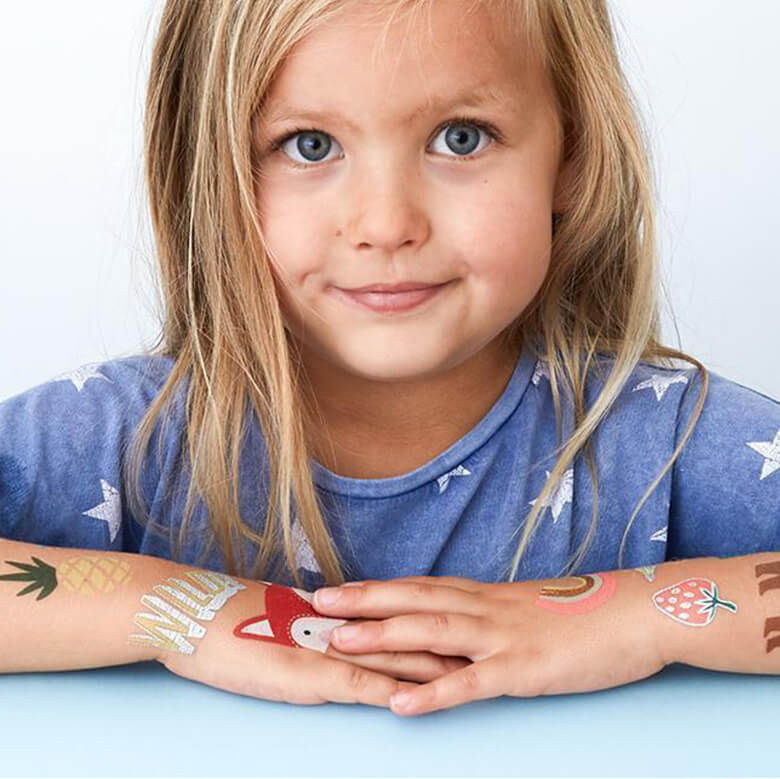 little girl with Temporary Tattoos on her arms