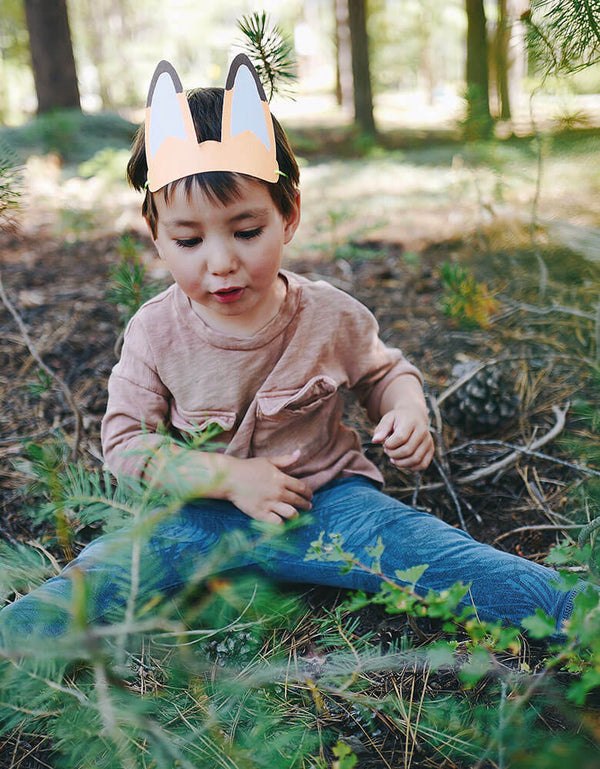 Boy in the wood wearing Fox Paper Animal Ears hat