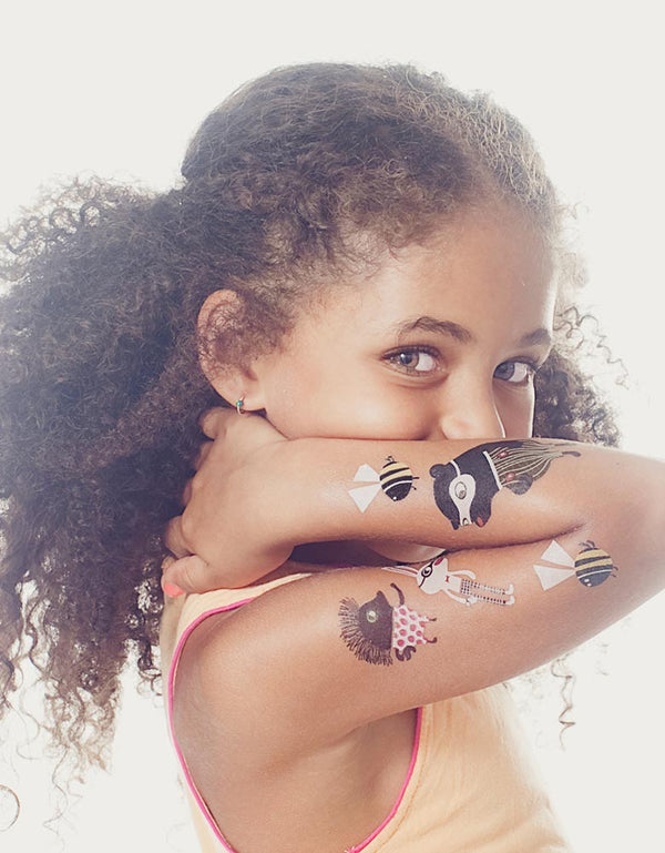 Girl with Cute Animal Temporary Tattoos on the Arm