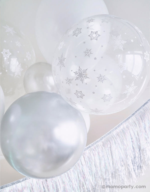 Close up details of White Christmas Balloon Cloud, featuring with 11 inch and 5 inch Qualatex Pearl white latex balloons, Chrome silver latex and clear with Snowflake print latex balloon, Meri Meri Silver Tinsel Fringe Garland  for a white christmas party, winter wonderland party, frozen party