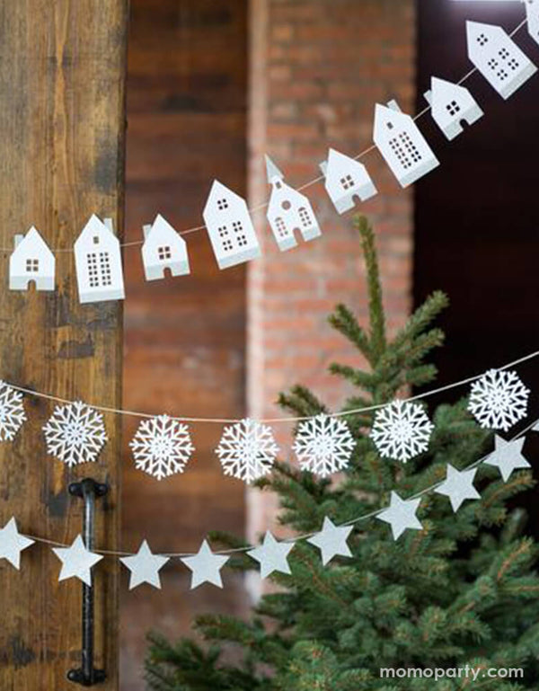 Winter White Christmas holiday sweet home decoration with My minds eyes' White Glitter Stars Banner and winter white house banner and classic snowflake banner in front of a christmas tree and rusty barn door for a white winter holiday celebration