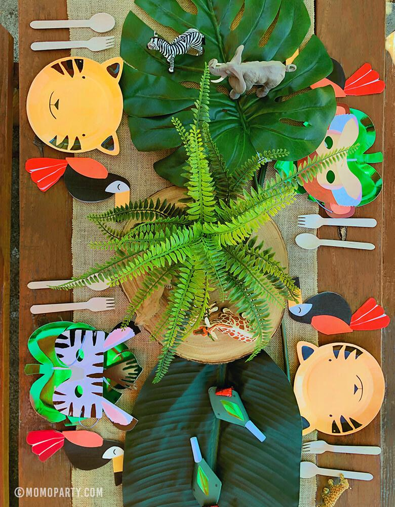 Safari Jungle Party Table Set Up with Tiger Paper Plates, Green Foil Palm Paper Plates, Animal Mask, Toucan Napkins, animal finger toys, snake blower as center piece decorations