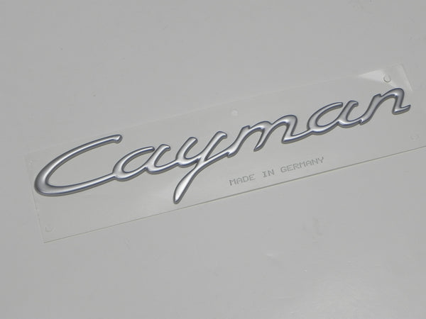 "(New) Satin Aluminum Emblem: ""Cayman"" - 2006-08"