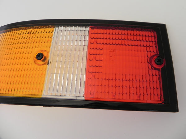 (New) 911/912/930 Genuine Left Side Euro Amber/Red/Clear Tail Light Lens with Black Trim - 1973-89