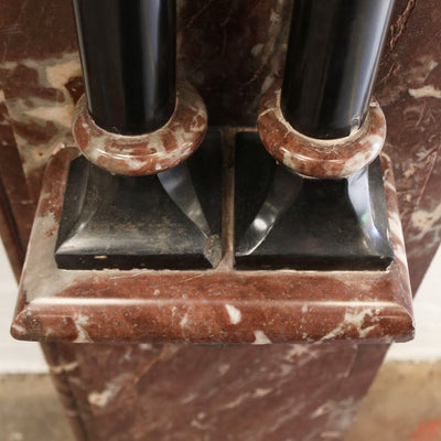 with hints of Belgian black marble pillar detailing