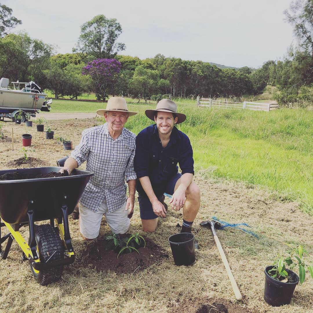 Alan and Sam Hutcherson working hard planting crops at Freshwater Farm Australia