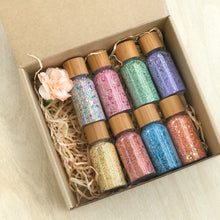 Load image into Gallery viewer, Box set of eight bottles of magic fairy potion dust.
