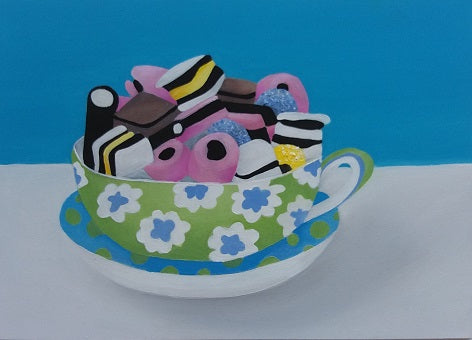Oil painting by artist Mandy Covington of a decorative teacup filled high with Liquorice Allsorts