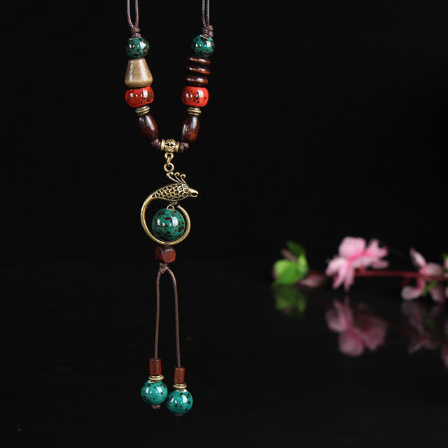 classical copper phoenix pendant with ceramic drop necklace