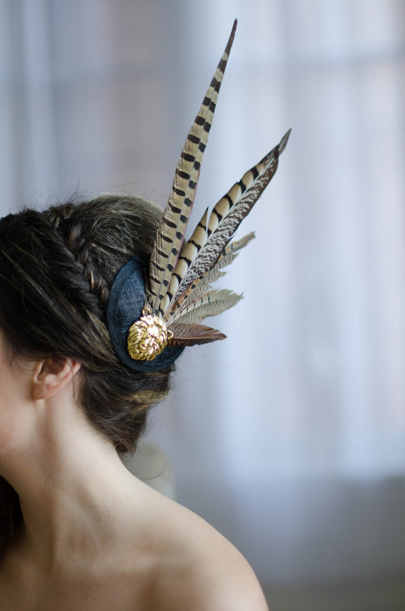 This couture pheasant feather cocktail hat would be the perfect complement to any rustic winter woodland wedding by adding a touch of sophistication and glamour.