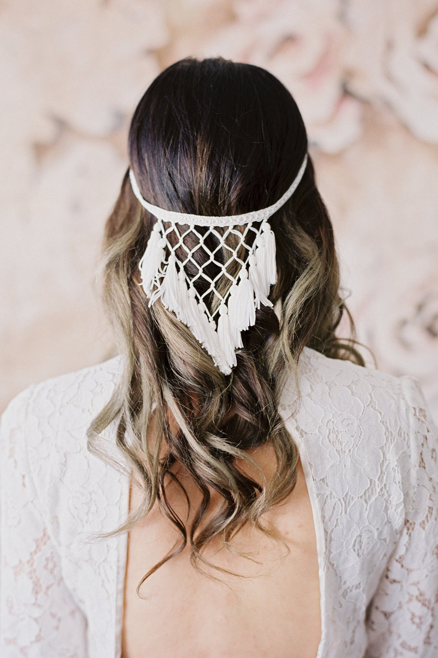 Danani Style #215 | Bride with long hair in soft curls wearing dreamcatcher fringe halo headpiece with tassels and macrame. Dress is Mojave by Elizabeth Dye. Hand painted wedding backdrop by Wildfield Paper Co. | Loblee Photography