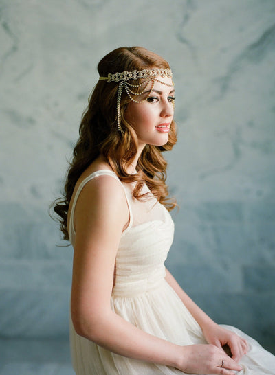 Danani Style #210 | Bride wearing flapper draped crystal 1920s halo forehead headband in gold for a Gatsby wedding | Loblee Photography