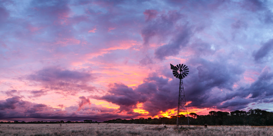 Sunset panorama with windmill