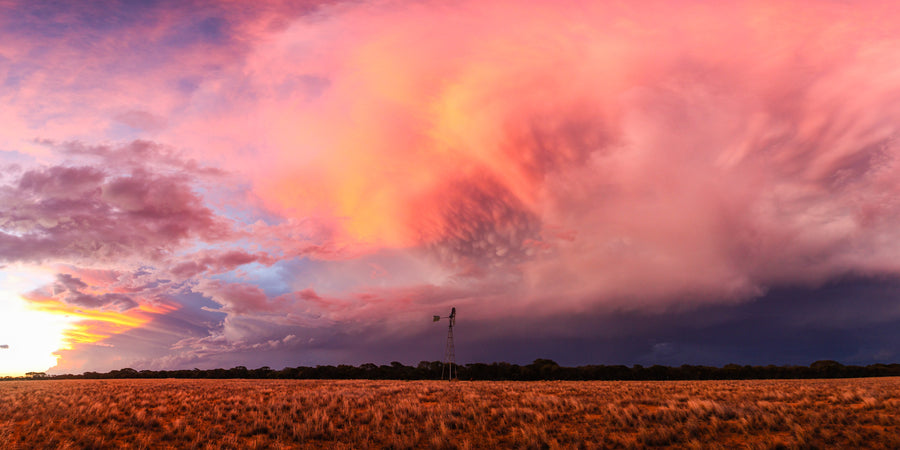 Thunderstorm sunset panorama with windmill