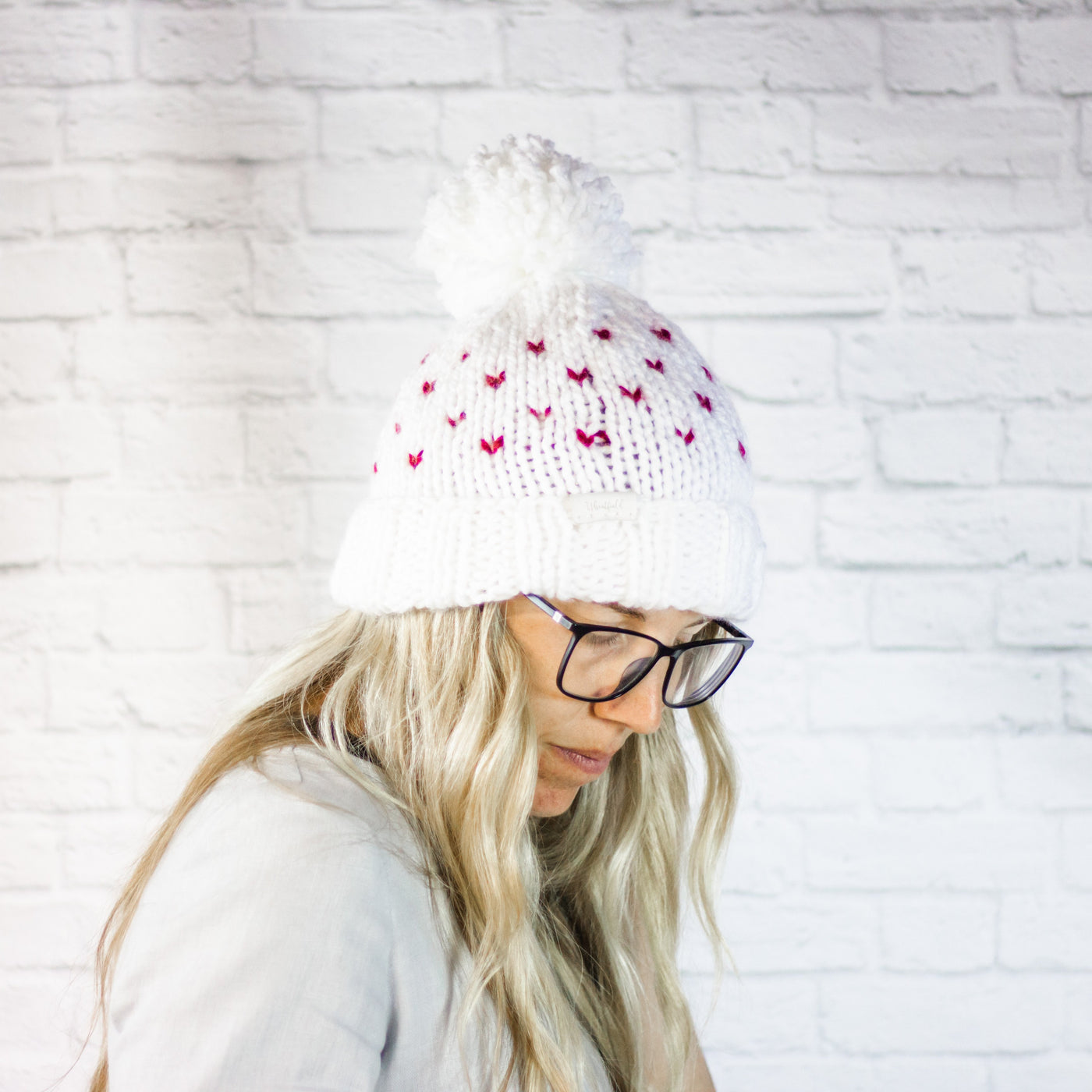 Wheatfield Knitwear Hats Knitted Mini Heart Beanie Hat with Pom Pom, Valentine's Day Accessory, Galentine's Gift for Her
