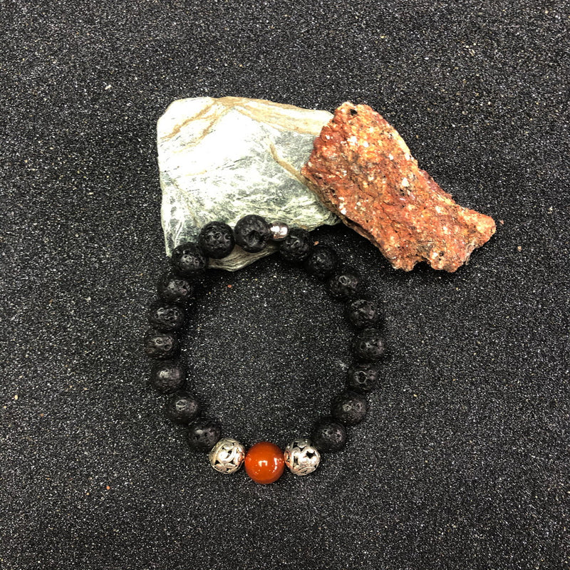 Black lava rock with Arabic style ball & orange agate pearl | bracelet