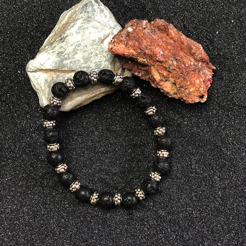 Black lava rock with 16 sterling silver spacers |  bracelet