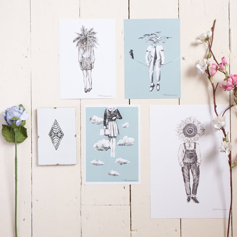 flatlay of various artist art work prints