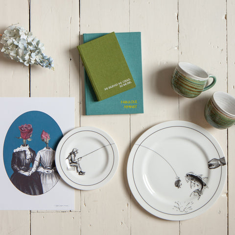 flatly image including notebooks, plates, mugs and prints