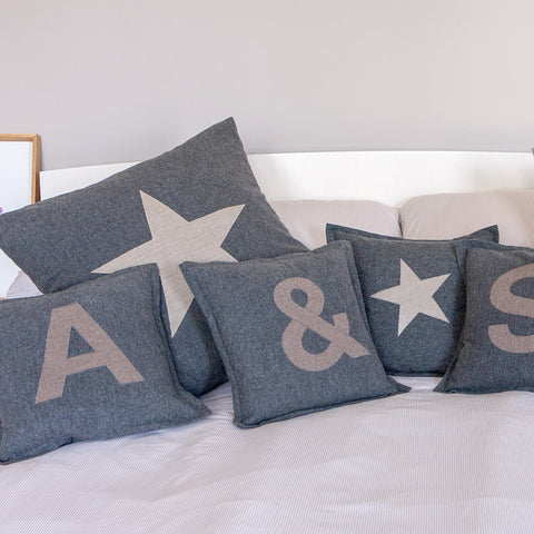 selection of scatter cushions spread across a bed