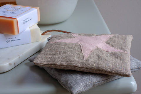 two lavender bags with star design on a dressing table